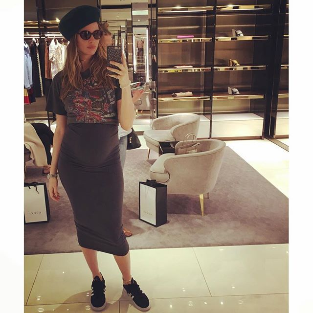 Pin for Later: Behati Prinsloo's Maternity Looks Are Our Idea of the Perfect Summer Wardrobe  Behati took her baby bump shopping, rocking a graphic tee, tight midi skirt, sneakers, and a beret.