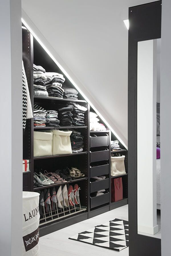 Neatly organized storage space for clothes designed from an awkwardly shaped section of wall. | Suomen kauneimpia koteja - Kannustalo
