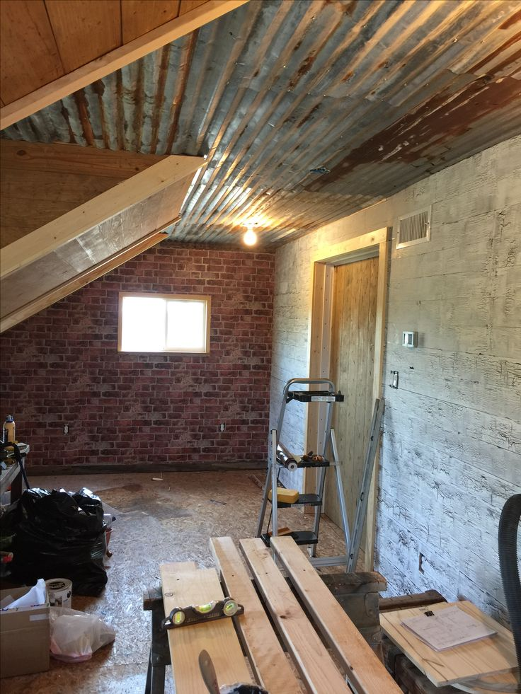 Rustic Tin Ceiling And Brick Wall.