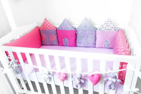 Playful house-shaped cot bumper will keep your little one entertained by bright colours and intricate details while protecting them from bumping into cot rails.