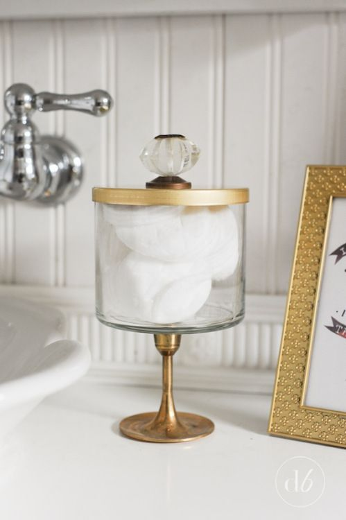 This blogger reimagined the candle accessory as a place to store all her cotton balls, gluing a handle onto the lid for easy access.  Get the tutorial at Dwell Beautiful »  - GoodHousekeeping.com