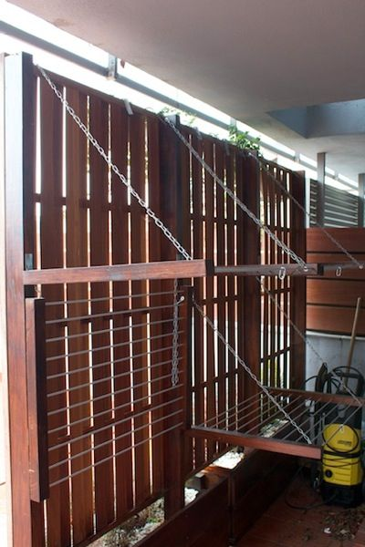 Outdoor drying racks attached to privacy screen