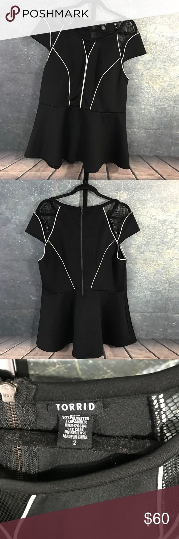 Torrid Black Net Peplum Top size 2 Black top with netting on sleeves and on front of top. White trim accents the top. Torrid Tops