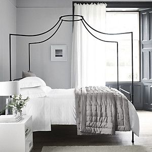 Black metal four poster bed. Get a similar one, The Waterloo, from the Original Bed Company.