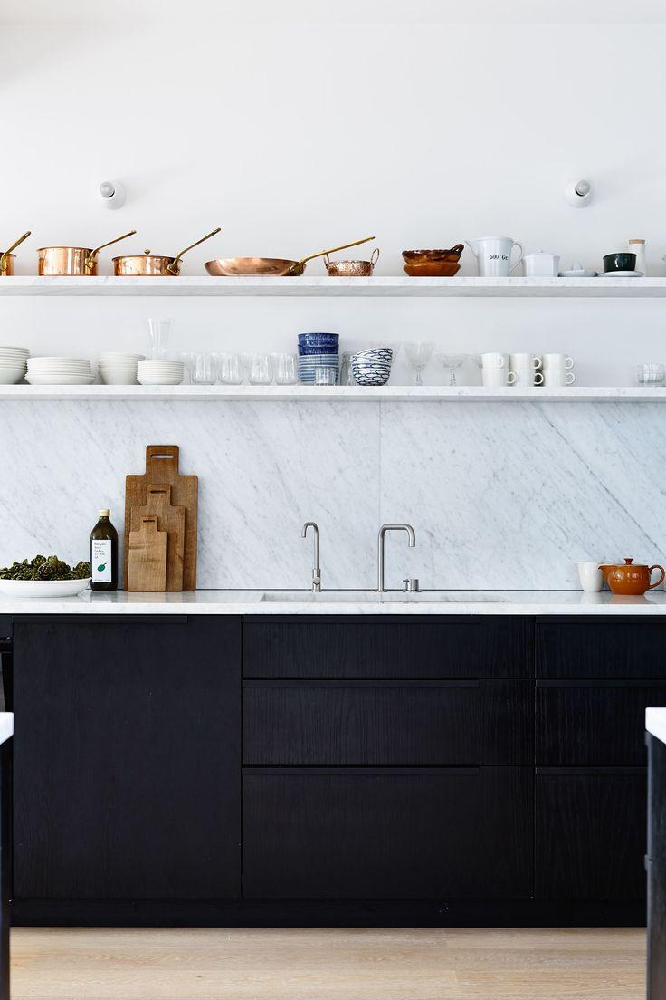 black kitchen cabinets, marble worktop and backsplash, open shelves