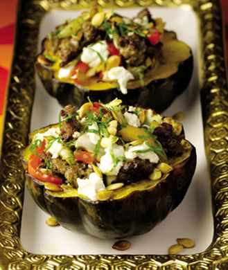 Guy Fieri: Roasted Acorn Squash with Turkey Sausage, Peppers, and Goat Cheese: