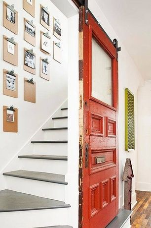 Eclectic Staircase with specialty door, High ceiling, Electric marquee arrow, Hardwood floors, Sparco clipboard