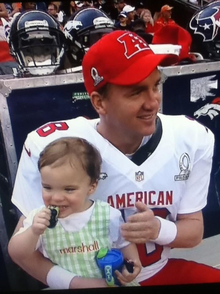 Not your typical NFL Sunday sideline shot. Broncos Quarterback Peyton Manning and his son, Marshall. #ProBowl