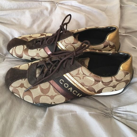Coach Sneakers Great black and gold sneakers. Hardly worn. Coach Shoes Sneakers