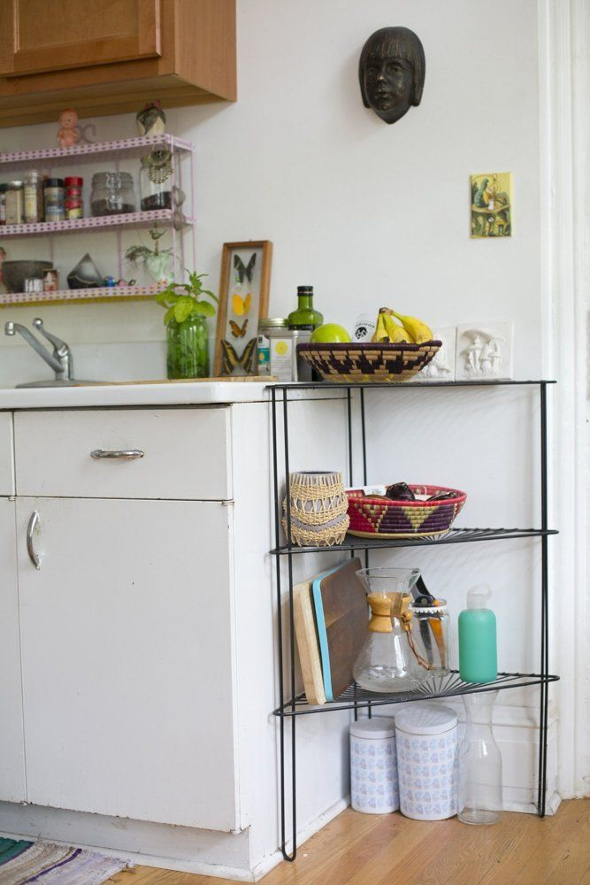Add a corner shelf to extend your storage in the kitchen.