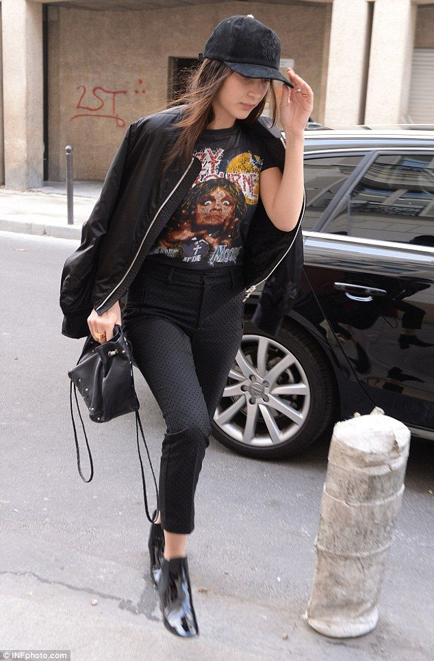 Low-key: The brunette beauty matched her statement fashion choice with a p[air of skinny j...