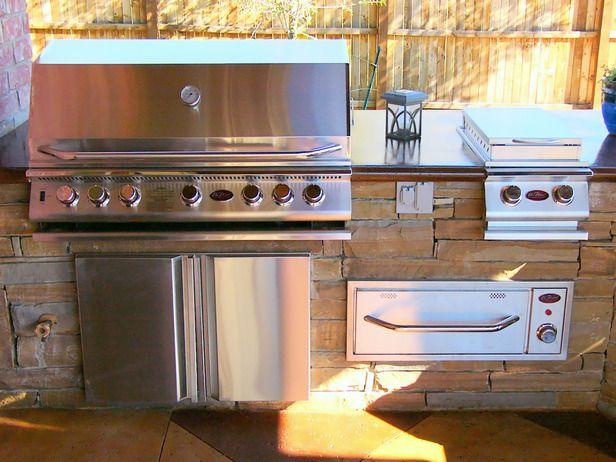 gourmet outdoor grill station w/chef-worthy appliances: grill, side burner, warming drawer & refrigerator.