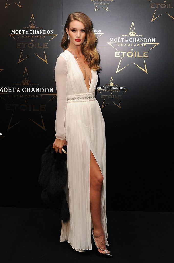 Rosie Huntington-Whiteley accessorized her sexy white dress at a London fete with jeweled black pumps. She finished off the look with loose side-swept curls.