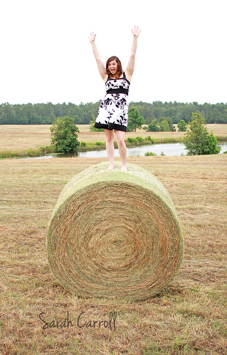 Senior girl poses - country hay bale