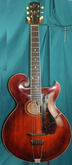 1918 Gibson tyle O.  Wait this is an acoustic guitar, not a mandolin?!?!?!?!  It's so cool!!!  I WANT IT!!!!!