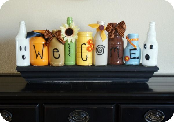 put a few drops of paint into some old bottles (ketchup/mustard/etc), shake it up to cover all areas, take puffy paint and write on the outside & finish off with ribbon/flowers/buttons ~ LOVE!