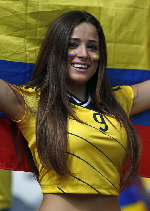 A Colombian supporter smiles as she waits for the start of the group C World Cup soccer match between Colombia and Greece at the Mineirao Stadium in Belo Horizonte, Brazil, Saturday, June 14, 2014