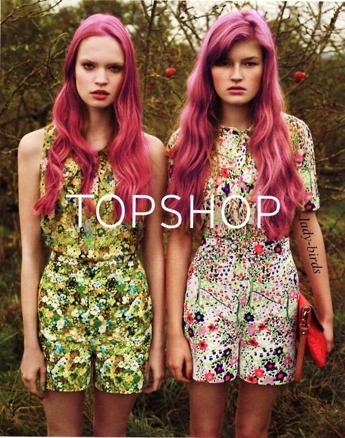 The twins. hair brightly colored, clothes matching, but opposite  always floral?