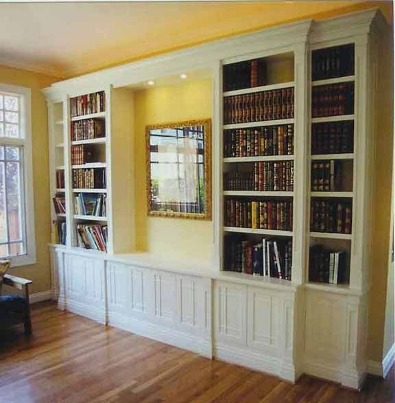 Built In Bookshelve: Staggered Crown And Moldings Add