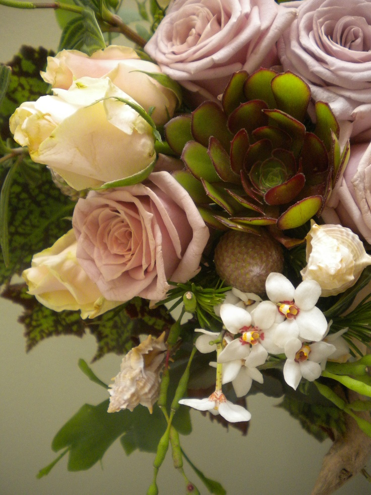Trailing bouquet with  sea shells, driftwood,Antique & Vendella roses, Hot Chocolate Calla Lily, native orchids, begonia & maidenhair foliage, Brunia, Aeonium & other assorted succulents