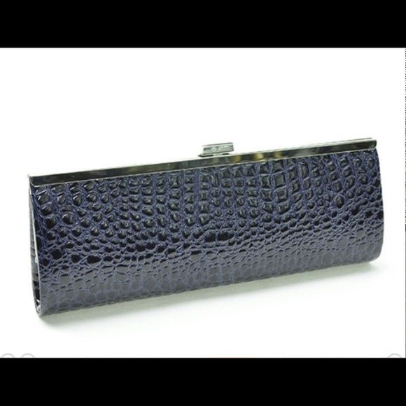 Classic Navy Clutch This classic faux croc clutch features a detachable silver shoulder strap, is fully lined with interior slip pocket, silver tone frame and clasp closure. Measures: 11W X 4H X 1.5 D (This closet does not trade or use PayPal ) Bags Clutches & Wristlets