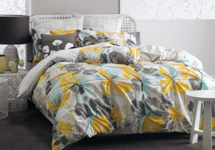 Deco Poppy Daze Quilt Cover Set. Brighten up your bedroom with this pretty yellow poppy quilt cover set printed on easy-care polyesyer/cotton. The piped quilt cover and pillowcases feature a special gathered technique and the reverse is a cute printed spot.