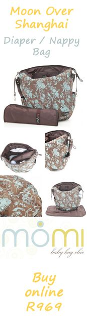 Neutral colour nappy bag and changing mat.