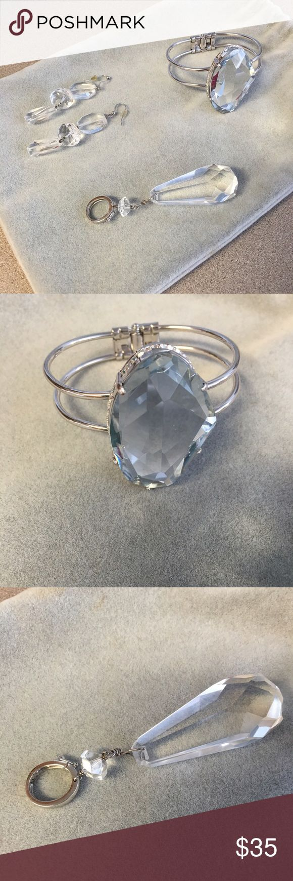 Quartz Bundle from home shopping Three pieces from home shopping-the earrings and pendant are Deb Guyot from HSN and is Quartz Look her up to see some comparable pieces I thought the bracelet was her also but it is stamped with a V on the back It is also Quartz and very sparkly in the way it's cut It was purchased in a home shopping channel as well These are beautiful pieces in great condition I just don't wear them Cats in home Deb Guyot Jewelry Bracelets