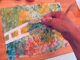 "Beautiful representations of ""Monet's Bridge over a Pond of Water Lilies"" using masking tape."