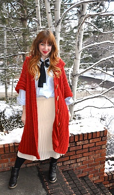 red crochet poncho with hood.