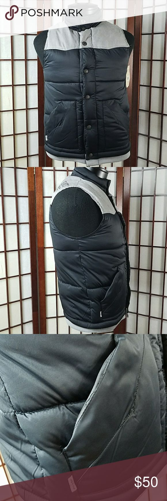 """Men's Puffer VEST SIZE SMALL New with tags  LEVI'S SIZE SMALL levis DENIM rrdmk. since 1873 embroidered on the right back shoulder  PUFFER VEST STYLE Buttons front  Two pockets Solid pattern  Made of polyester and cotton  Measurements Approximate  Pit to pit 18.5"""" Shoulder to hem 24"""" Levi's Jackets & Coats Vests"""