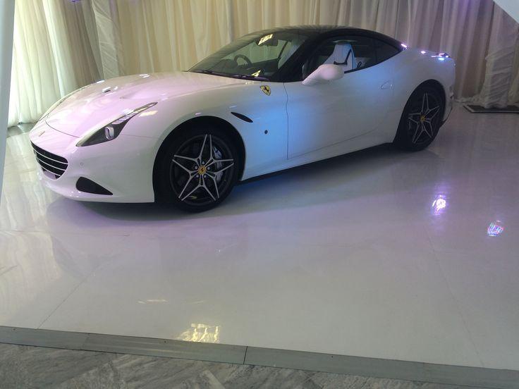 sleek white ABS Connecta-Floor displaying a sleek white Ferrari April 2015