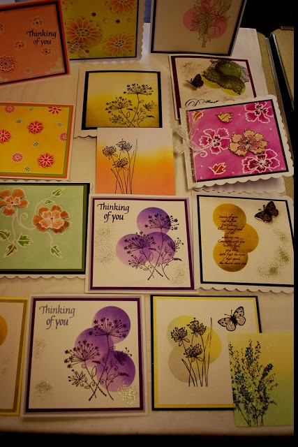 By Eileen Godwin's workshop students. They used pastels. I would sponge. I like the purple circles with flowers. Circles can be made by sponging inside a die-cut circle.