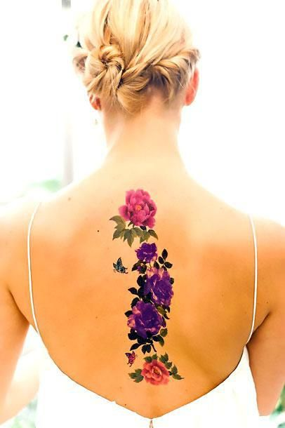 It is the best flowers tattoo placed on the spine. It can make any woman's back sexy.