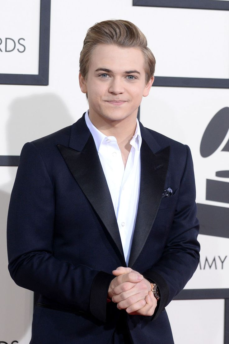 """Nominated for best country solo performance, singer Hayes of """"I Want Crazy,"""" arrived in a navy blue blazer and a white shirt."""