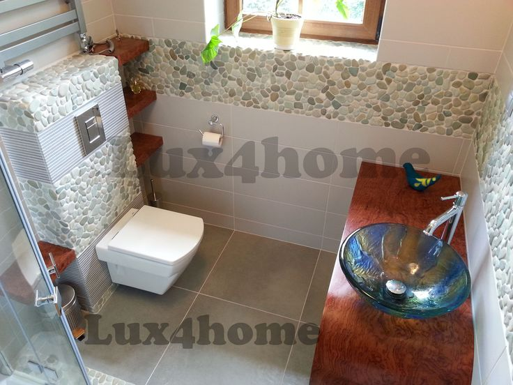 Pebble Tiles Lux4home™.  http://www.lux4home.com/products/pebble/
