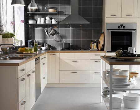 classic kitchen with white ikea kitchen cabinets with vermont marble countertops and subway tile backsplash kitchen island polished chrome bar stools