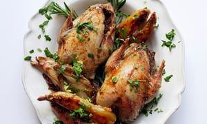 Partridges on a plate scattered with watercress