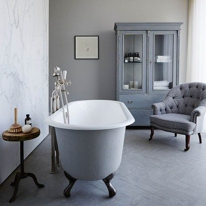 A free-standing tub from C P Hart blends in with the bathroom's grey palette.
