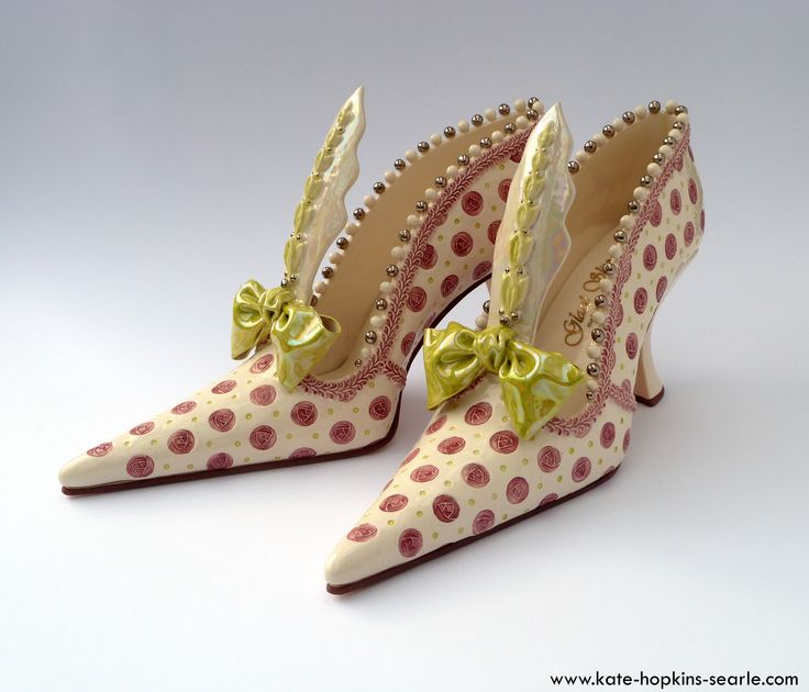 Hand made ceramic shoes by Kate Hopkins Searle; with pink flowers, green bows & ridiculously high tongues