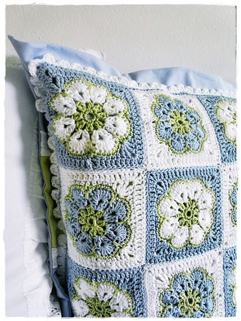 from the blog  holy crap yarn and stuff      Here's some more of that amazing African Flower stitch - this time on a lovely cushion.  Blissful colours right?  Found via the pretty German blog Kirsten meine Welt