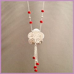 'Drops of Poppy' necklace - a hand finished sterling silver floral necklace, decorated with fine scrollwork, and accented with s-silver beads and coral, as bright red as summer poppies. Feminine and delicate, with a gay Gatsby swing to it, this is perfect jeans jewelry for lunch with girlfriends, family dinners, taking the kids to the park.  Pretty and fun. Suspended from a 24 inch s-silver chain. Buy for $128.45 at…