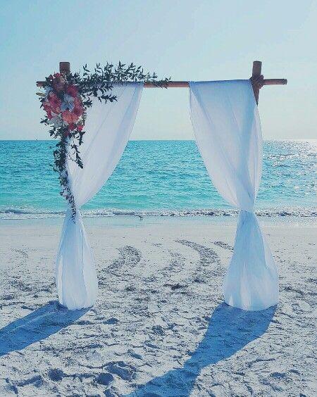 Bamboo Wedding Arch: Ritz at Lido Beach Sarasota Florida . By Scarlett's Flowers