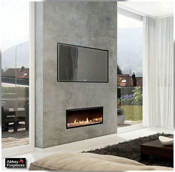 This Is The Gas Fireplace Surrounded By Polished Concrete