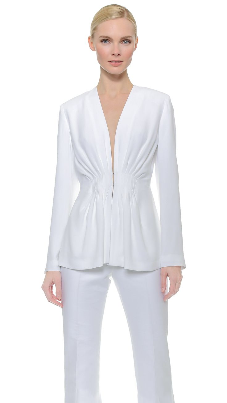 From Cushnie et Ochs, a beautiful and interesting jacket.  They've taken a classically soft, dressy fabric, lightweight white crepe, and combined it with a familiar Active Wear jacket silhouette.  Sporty Angel? Dunno, but it is effective and fresh.  Wear it over jeans, or dress it up with a Frilled Crepe Skirt, Lots of Pave Diamonds and Sexy Silver Open-Arch Pumps (All on this board).  Yea! - Gabrielle