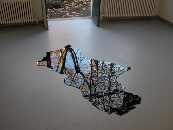 beautiful silver ring Tragaluz  2005 by Jorge Santos Mirrored black Plexiglas with drawing of puddle tree reflex