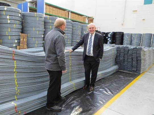 The Honourable Steven Joyce with our PB-1 pipe lengths and coils in the Buteline manufacturing facility in East Tamaki, Auckland.