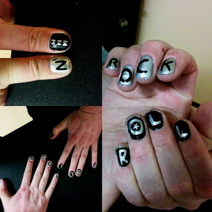 Black and silver rock n' roll nails with studs on the thumb.