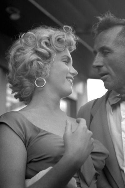 """Marilyn Monroe with photographer Earl Thelsen at a party celebrating Ray Anthony's song """"Marilyn"""""""