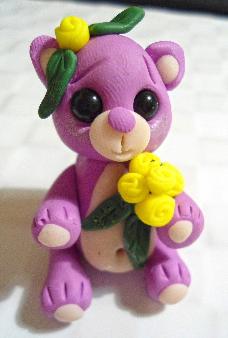 Polymer Clay bear with yellow roses. Made from Fimo